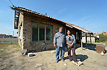 """Vassil Ivanov (left) lives in the Bulgarian town of Staro Oriahovo, where residents consider the term """"Roma""""  to be negative and thus refer to themselves as Romanian-speaking Bulgarians. Ivanov is a member of the local United Methodist Church. Here he poses in front of his home with his adult daughter, Pauna Vassilev, who most of the year works as a elder caregiver in Greece."""