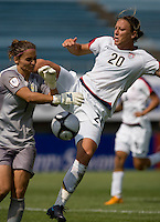 USWNT forward (20) Abby Wambach tries to get a touch on the ball as  Australian goalkeeper (1) Melissa Barbieri comes in during the Peace Queen Cup  in Suwon, South Korea.  The U.S. defeated Australia, 2-1, at the Suwon Sports Complex.