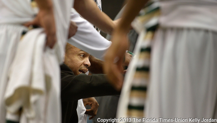 Kelly.Jordan@jacksonville.com--021513--JU head coach Cliff Warren talks to his team during a timeout as Jacksonville University takes on the University of North Florida in mens basketball during the River City Rumble at the Veterans Memorial Arena in Jacksonville, Florida Friday night, February 15, 2013.(The Florida Times-Union, Kelly Jordan)