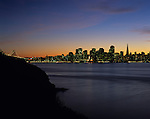 Retro Image of San Francisco downtown skyline at sunset with city lights in bay from Treasure Island, San Francisco, California USA