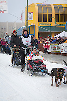 Jodi Bailey and team leave the ceremonial start line at 4th Avenue and D street in downtown Anchorage during the 2013 Iditarod race. Photo by Jim R. Kohl/IditarodPhotos.com
