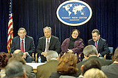 """Washington, DC - March 28, 2003 -- United States Deputy Secretary of Defense Paul Wolfowitz briefs international media at the Foreign Press Center in Washington, DC on March 28, 2003 on """"Eliminating the threat to World Security Posed by the Iraqi Regime and Halting the Torture, Imprisonment and Execution of Innocents"""". He was accompanied by a group of Iraqi-Americans. From left to right: Deputy Secretary Paul Wolfowitz, Emad Dhia, Zakiya Hakki, and Sam Kareem.<br /> Credit: Ron Sachs / CNP"""
