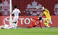 TORONTO, ON - OCTOBER 15: Zack Steffen #1 of the United States attempts to make a save off of Alphonso Davies #12 of Canada during a game between Canada and USMNT at BMO Field on October 15, 2019 in Toronto, Canada.