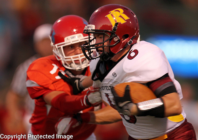 SIOUX FALLS, SD - SEPTEMBER 9:  Justin Warne #6 from Roosevelt tries to shake the grasp of Matt VanderWoude #11 from Lincoln in the second quarter of their game Friday night at Howard Wood Field. (Photo by Dave Eggen/Inertia)
