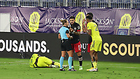 NASHVILLE, TN - SEPTEMBER 23: Referee Tori Penso is confronted by Junior Moreno #5 and Gelmin Rivas #20 of DC United and Anibal Godoy #20 of Nashville SC after a foul on Derrick Jones #21 of Nashville SC during a game between D.C. United and Nashville SC at Nissan Stadium on September 23, 2020 in Nashville, Tennessee.