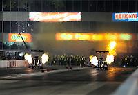 May 20, 2011; Topeka, KS, USA: NHRA top fuel dragster driver Terry McMillen (left) races alongside David Grubnic  during qualifying for the Summer Nationals at Heartland Park Topeka. Mandatory Credit: Mark J. Rebilas-