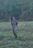 Matt Hughes brings a dove back to his hunting spot.<br />