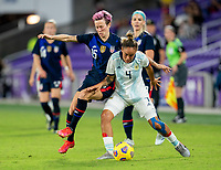ORLANDO, FL - FEBRUARY 24: Megan Rapinoe #15 of the USWNT fights for the ball with Marina Delgado #4 of Argentina during a game between Argentina and USWNT at Exploria Stadium on February 24, 2021 in Orlando, Florida.