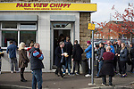 Burnley 1 West Ham United 3, 18/10/2014. Turf Moor, Premier League. Home supporters queueing for fish and chips near Turf Moor, home of Burnley FC, before the club hosted West Ham United in an English Premier League match. The fixture was won by the visitors by three goals to one watched by 18,936 spectators. The defeat meant that Burnley still had not won a league match since being promoted from the Championship the previous season. Photo by Colin McPherson.