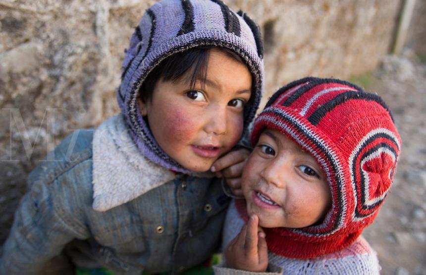 Lukla Nepal Young children pose in alley in Lukla Solukhumbu 54