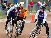 19 APR 2015 - IPSWICH, GBR - Leon Mower (left) of Ipswich Eagles and Gavin Parr (centre) of Sheffield Stars battle for position during the two teams Elite League cycle speedway fixture at Whitton Sports and Community Centre in Ipswich, Suffolk, Great Britain  (PHOTO COPYRIGHT © 2015 NIGEL FARROW, ALL RIGHTS RESERVED)