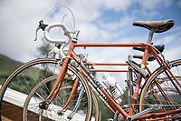 Up the Col de Peyresourde this beautiful old Molteni teamcar awaits the peloton (with original Eddy Merckx bikes on the roof-rack)<br /> <br /> Stage 12: Toulouse to Bagnères-de-Bigorre(209km)<br /> 106th Tour de France 2019 (2.UWT)<br /> <br /> ©kramon