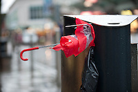 Wednesday 12 February 2014<br /> Pictured: A broken umbrella is placed in the bin <br /> Re: People struggle with the high winds in the center of Swansea. The met office has today issued more warnings of extreme weather over the next few days.