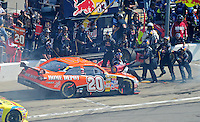 Sept. 28, 2008; Kansas City, KS, USA; Nascar Sprint Cup Series driver Tony Stewart runs into the gas man on the pit crew of Brian Vickers (not pictured) on pit road during the Camping World RV 400 at Kansas Speedway. Mandatory Credit: Mark J. Rebilas-