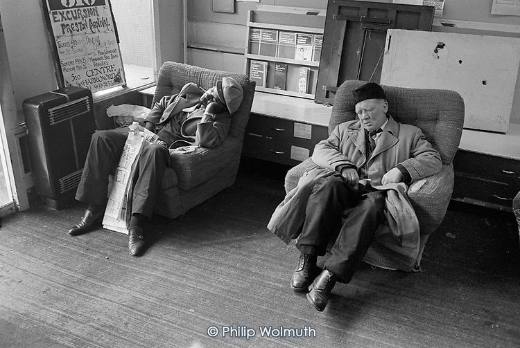 Two men sleeping in the reception area of the 510 Community Centre, Harrow Road, North Paddington, London.