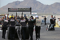 Apr. 5, 2013; Las Vegas, NV, USA: NHRA crew members for top fuel dragster driver Brittany Force during qualifying for the Summitracing.com Nationals at the Strip at Las Vegas Motor Speedway. Mandatory Credit: Mark J. Rebilas-