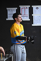 Ian Dawkins (8) of the Los Rapidos de Kannapolis stands in the dugout during a game against Las Llamas de Hickory at L.P. Frans Stadium on July 17, 2019 in Hickory, North Carolina. The Llamas defeated the Rapidos 7-5. (Tracy Proffitt/Four Seam Images)