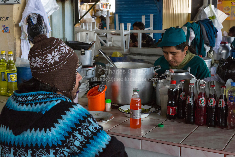 Peru, Cusco, San Pedro Market.  Customer Eating in the Food Court Area of the Market.