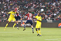 Chivas forward Justin Braun (17) heads first goal of the night during the first half of the game between Chivas USA and the Columbus Crew at the Home Depot Center in Carson, CA, on July 31, 2010. Chivas USA 3, Columbus Crew 1.