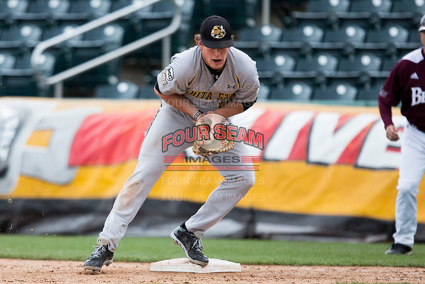 Casey Gillaspie #16 of the Wichita State Shockers cradles a ball thrown to first base during a game against the Missouri State Bears at Hammons Field on May 5, 2013 in Springfield, Missouri. (David Welker/Four Seam Images)