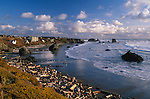 Bandon Beach from Coquille Point wayside, with sea stacks, driftwood and beach houses; Oregon coast.