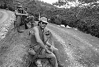 - Nicaragua, volunteers of the brigades of work assigned to the coffee harvest and the defense of the plantations from the counter-revolutionary guerrilla in a farm  north of Jinotega (Gennaio 1988) <br /> <br /> - Nicaragua, volontari delle brigate del lavoro addetti alla raccolta del caffè e alla difesa delle piantagioni dalla guerriglia controrivoluzionaria in una fattoria a nord di Jinotega (January 1988)