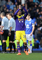 Pictured: Jonathan de Guzman thanks away supporters. Sunday 16 February 2014<br /> Re: FA Cup, Everton v Swansea City FC at Goodison Park, Liverpool, UK.