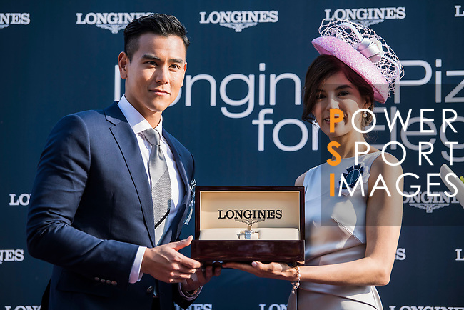 Eddie Peng, Longines Ambassador of Elegance, presents the prize to the winner of the Longines Prize for Elegances Presentation during the Longines Hong Kong International Races at Sha Tin Racecourse on December 10 2017, in Hong Kong, Hong Kong. Photo by Victor Fraile / Power Sport Images