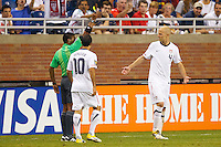 7 June 2011: Referee Walter Lopez give USA Men's National Team midfielder Michael Bradley (4) a yellow card during the CONCACAF soccer match between USA MNT and Canada MNT at Ford Field Detroit, Michigan. USA won 2-0.