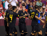 Thiago (4) is congratulated on his goal by teammate Cuenca (29) of Barcelona during the friendly at FedEX Field in Landover, MD.  Manchester United defeated FC Barcelona, 2-1.