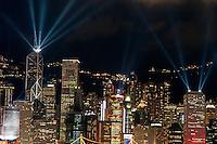 Laser show over city at night, Hong Kong, China.
