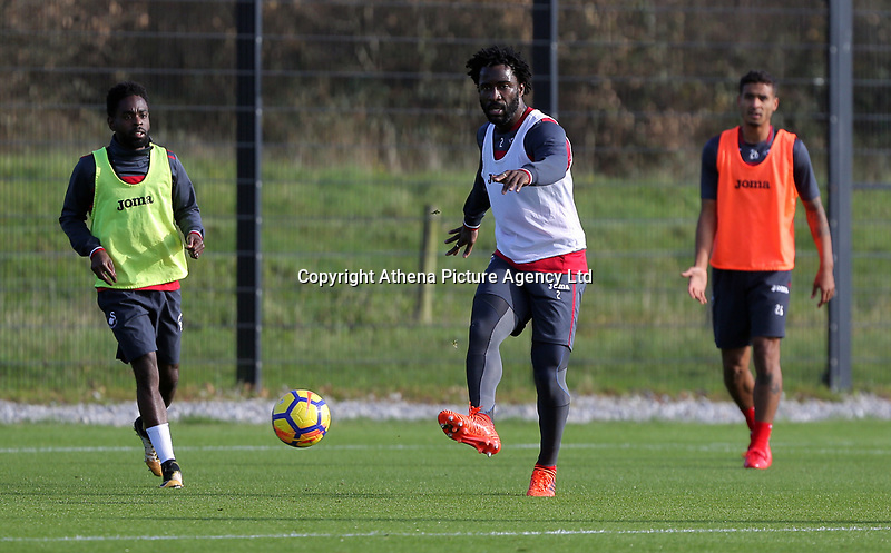 Wilfried Bony (C) passes the ball during the Swansea City Training at The Fairwood Training Ground, Swansea, Wales, UK. Wednesday 01 November 2017