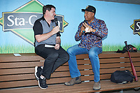 Charlotte Knights radio analyst Mike Pacheco (left) interviews former New York Yankees center fielder Bernie Williams prior to the International League game against the Scranton/Wilkes-Barre RailRiders at BB&T BallPark on August 13, 2019 in Charlotte, North Carolina. The Knights defeated the RailRiders 15-1. (Brian Westerholt/Four Seam Images)