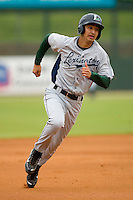 Jiovanni Mier #3 of the Lexington Legends hustles towards third base against the Kannapolis Intimidators at Fieldcrest Cannon Stadium April 14, 2010, in Kannapolis, North Carolina.  Photo by Brian Westerholt / Four Seam Images
