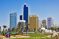 Commercial buildings, Abu Dhabi Investment Authority Tower, park, mosque and childrens? playground.  Abu Dhabi city centre/center..United Arab Emirates.