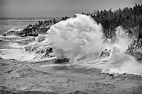 """""""The Big One""""<br /> The wild waves and freezing spray painted winter along Lake Superior's North Shore. Photographing in these conditions can be challenging. In addition to maintaining stability in the strong winds, spray from huge waves pelts us and our gear, freezing within seconds. Yet, we eagerly head to her shores to witness her power and fury. While the wave heights during this storm were 15+ feet, some of the exploding waves and spray likely topped 70 feet, based upon the size of nearby trees."""