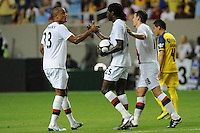 Teammates congratulate forward Emmanuel Adebayor after his penalty kick gave Manchester City a 1-0 first-half lead. The 2010 Atlanta International Soccer Challenge was held, Wednesday, July 28, at the Georgia Dome, featuring a match between Club America and Manchester City. After regulation time ended 1-1, Manchester City was awarded the victory, winning 4-1, in penalty kicks.