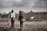 Wau, South Sudan. 21 March 2011...Employees go to work leaving their homes on the outskirts of Wau, the second largest city in Southern Sudan..