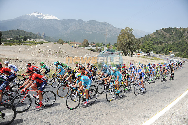 The peloton under the snow capped Taurus Mountains during Stage 3 of the 2015 Presidential Tour of Turkey running 165.3km from Kemer to Elmali. 28th April 2015.<br /> Photo: Tour of Turkey/Mario Stiehl/www.newsfile.ie
