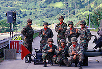 National Guard troops (Alpha Battery) at the H-3 Interstate Highway, providing protection during the opening marathon run across the controversial highway, Kaneohe, Oahu