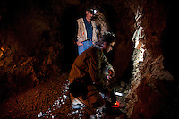 My brother-in-law using a Niton XRF analyzer to measure rock chemistry inside an abandoned mine shaft, part of a gold exploration project.