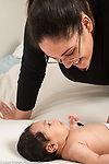 Infant development newborn baby girl age 6 weeks interaction with mother
