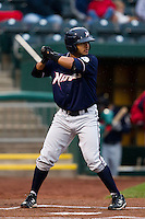 Christian Colon (4) of the Northwest Arkansas Naturals at bat during a game against the Springfield Cardinals on May 13, 2011 at Hammons Field in Springfield, Missouri.  Photo By David Welker/Four Seam Images.