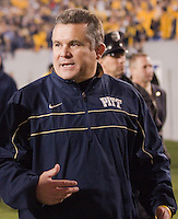 Pitt head coach Todd Graham walks off of the field after the loss.The WVU Mountaineers beat the Pitt Panthers 21-20 at Mountaineer Field in Morgantown, West Virginia on November 25, 2011.
