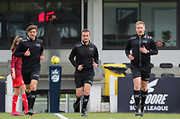 Assistant referee Gianni Seeldraeyers , match referee Thomas Vanboven and Assistant referee Jiri Bergs pictured warming up before a female soccer game between Oud Heverlee Leuven and Standard femina de liege on the 5 th matchday of play off 1 in the 2020 - 2021 season of Belgian Womens Super League , saturday 8 th of May 2021  in Heverlee , Belgium . PHOTO SPORTPIX.BE | SPP | SEVIL OKTEM