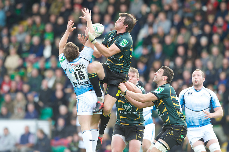 Tom Wood of Northampton Saints competes for the re-start ball against Finlay Gillies of Glasgow Warriors during the Heineken Cup match between Northampton Saints and Glasgow Warriors  at Franklin's Gardens on Sunday 14th October 2012 (Photo by Rob Munro)