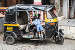 Mumbai, India<br /> Just along from the richer Bandra West area where Bollywood stars live is a poor tiny  inner city village -<br /> Small boy in leg braces plays on an auto rickshaw whilst playing peekaboo with a friend.<br /> <br /> <br /> Picture by Gavin Rodgers/ Pixel8000<br />  07917221968