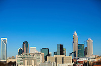 A skyline view of downtown Charlotte North Carolina shows Bank of America's shiny (glassy) new tower, still under construction early 2010. Photo by Charlotte-based photographer Patrick Schneider.