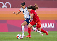 KASHIMA, JAPAN - AUGUST 2: Christen Press #11 of the USWNT sprints past Allysha Chapman #2 of Canada during a game between Canada and USWNT at Kashima Soccer Stadium on August 2, 2021 in Kashima, Japan.