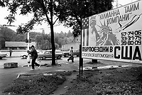 Russian Federation. Krasnodar Krai Region. Krasnodar. Street scene. Signboard in cyrillic script for a travel agency selling trips to the United States of America USA) with a dawing of thr , phone numbersStatue of Liberty and a flying plane. Krasnodar (also known as Kuban) is the largest city and the administrative centre of Krasnodar Krai in Southern Russia. 17.09.93 © 1993 Didier Ruef